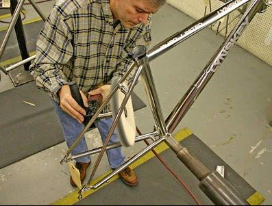 Someone at Lynskey draws the short straw and has to Fully Polish a frame - you end up with a mirrored 'chrome' look.