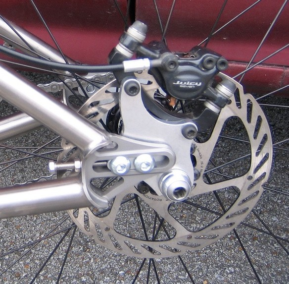 The classic Paragon adjustable sliding dropout - with the brake calliper mounted on the dropout adjusting chain tension is easy...